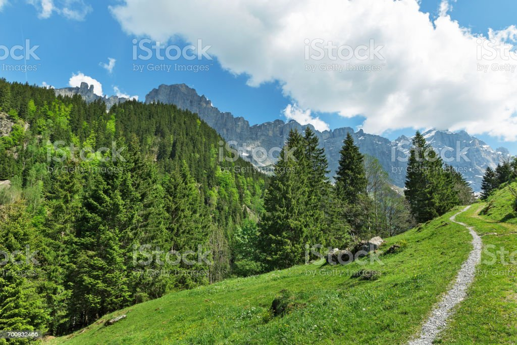 road against the background of mountains in the Alps stock photo