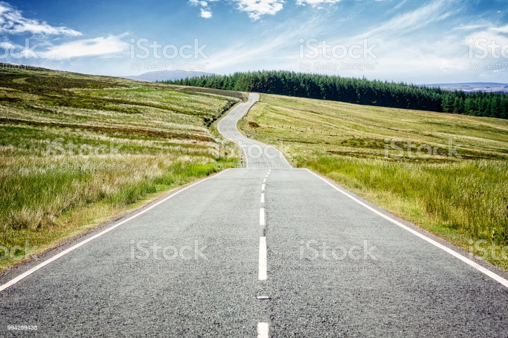 Road ahead highway disappearing into the distance