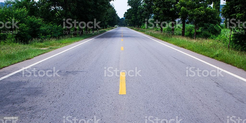 Road ahead in afternoon stock photo
