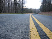 A detail of a road in North Carolina.