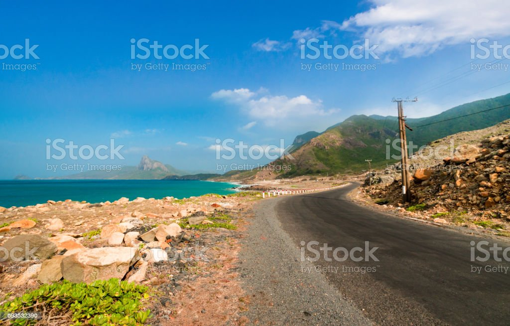 Road along the turquoise sea white sand and rocky under sunshine very beautiful nature at Bai nhat beach stock photo