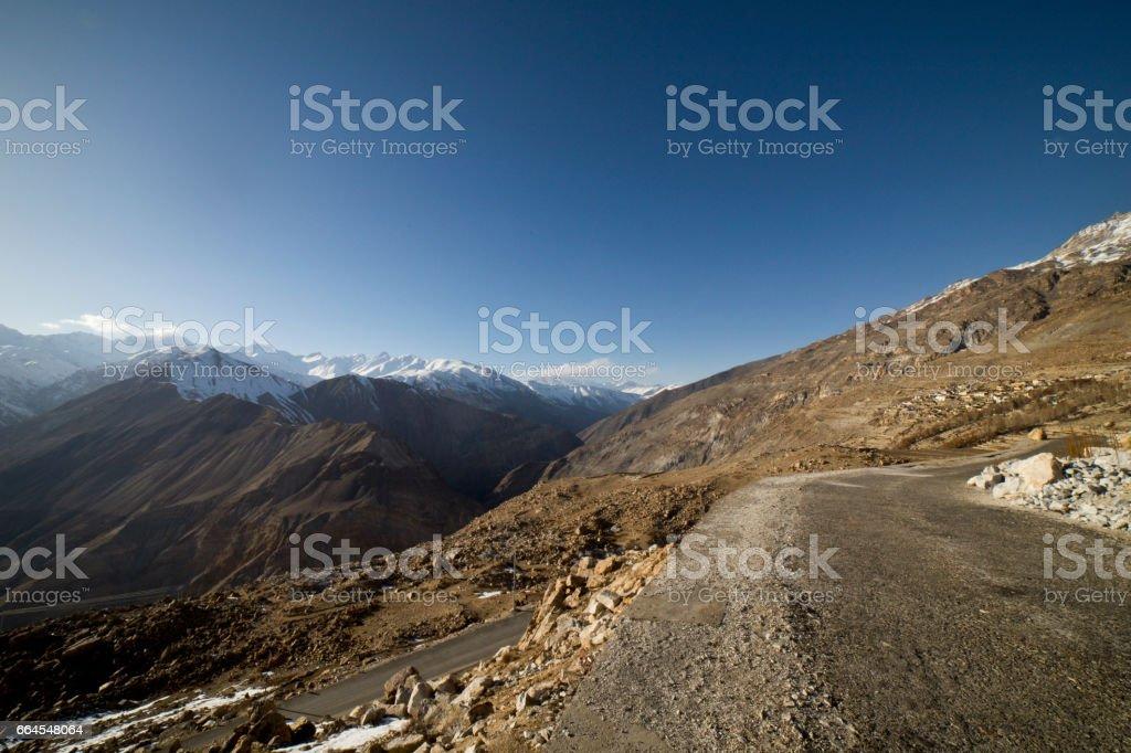 Road amidst Himalayan mountain royalty-free stock photo