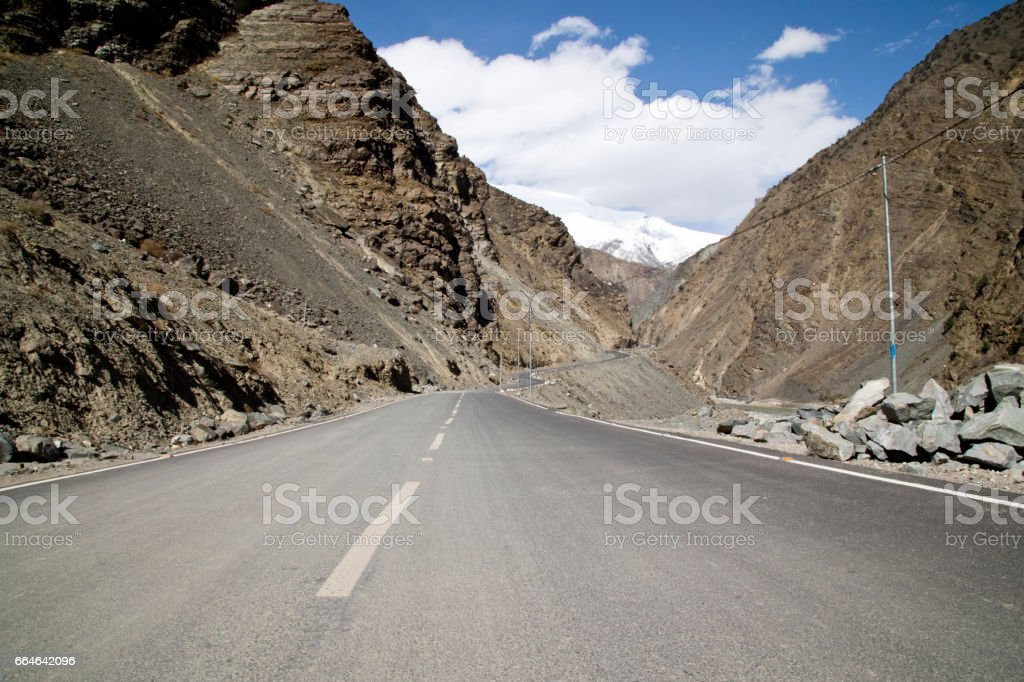 Road amidst Himalayan mountain stock photo