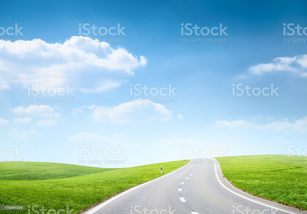 Road among hilly fields stock photo