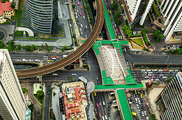 Road and BTS station in Bangkok, Thailand. Road and BTS station in Bangkok, Thailand. bus rapid transit stock pictures, royalty-free photos & images