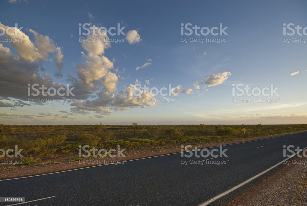 Road and Clouds at sunset in Western Australia royalty-free stock photo