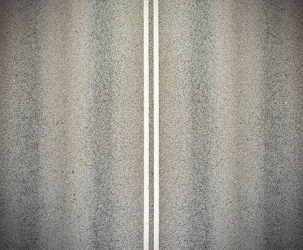 Road e doppie righe bianche - foto stock