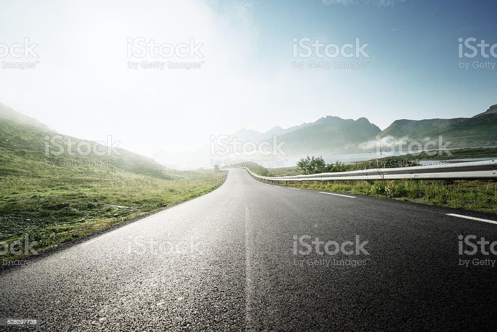 road and fog, Lofoten island, Norway stock photo