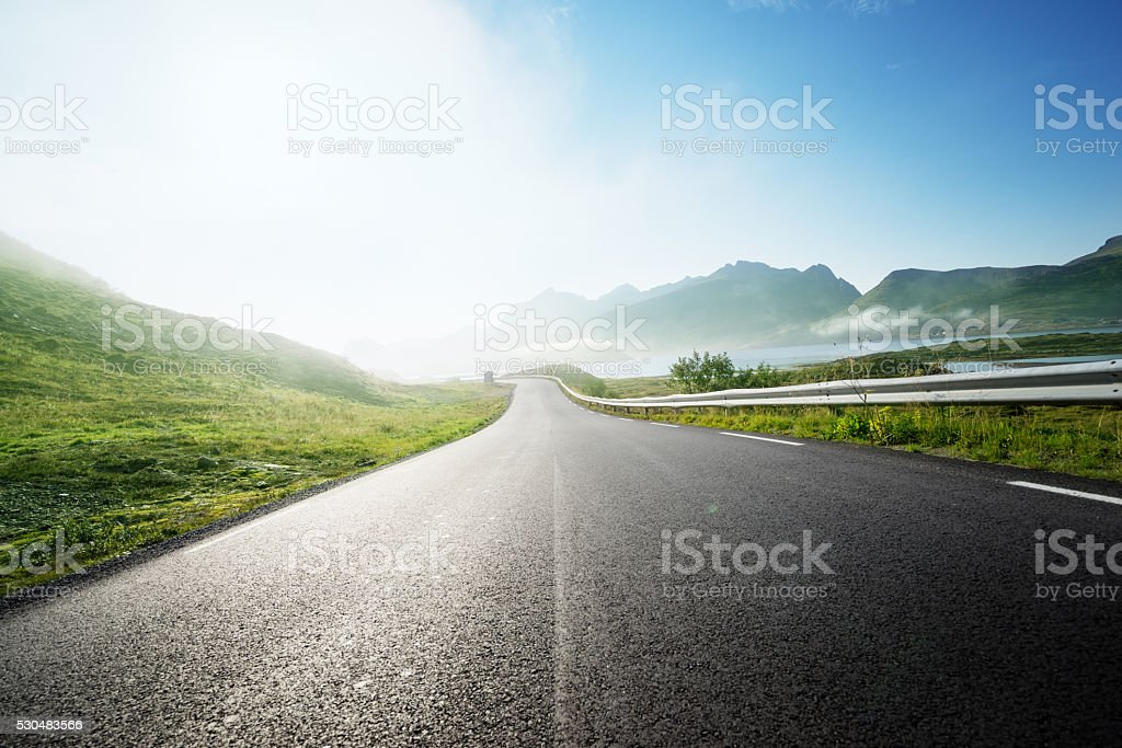 road and fog, Lofoten island, Norway stock photo