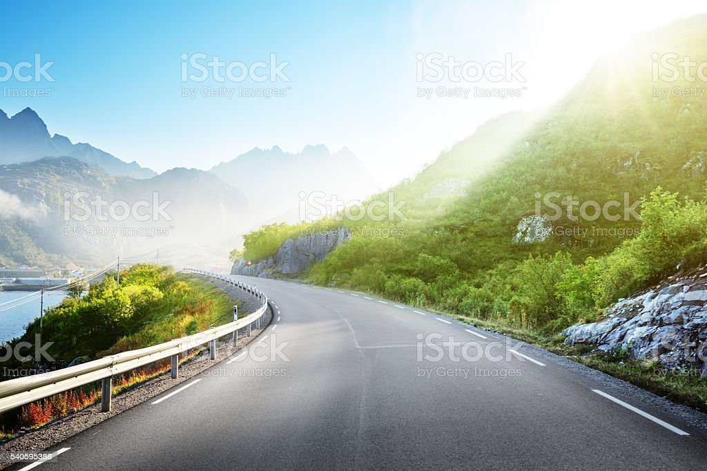 road and mist, Lofoten islands, Norway stock photo