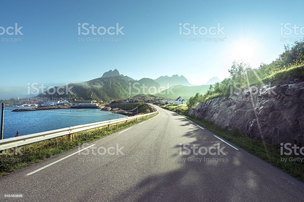 road and mist, Lofoten islands, Norway stock photo