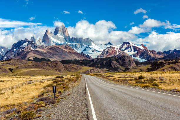 Road and panorama with Fitz Roy mountain at Los Glaciares National Park stock photo