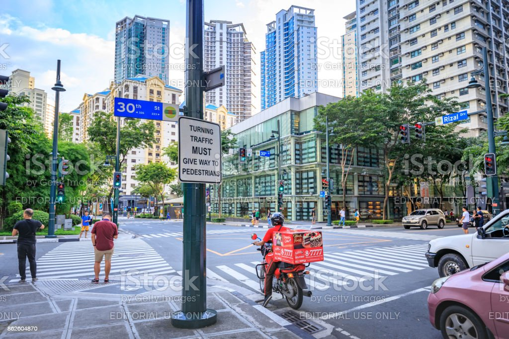 Road and skyscrapers at Bonifacio Global City on Sep 1, 2017 in Taguig, Manila, Philippines stock photo