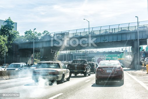 New York City: Road and street highway in NYC with sign for George Washington Bridge, smoke coming out of exhaust pipe of car