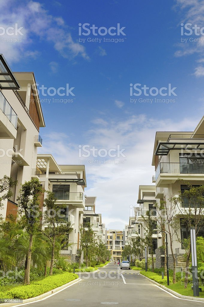 Road and two rows of new terrace houses royalty-free stock photo