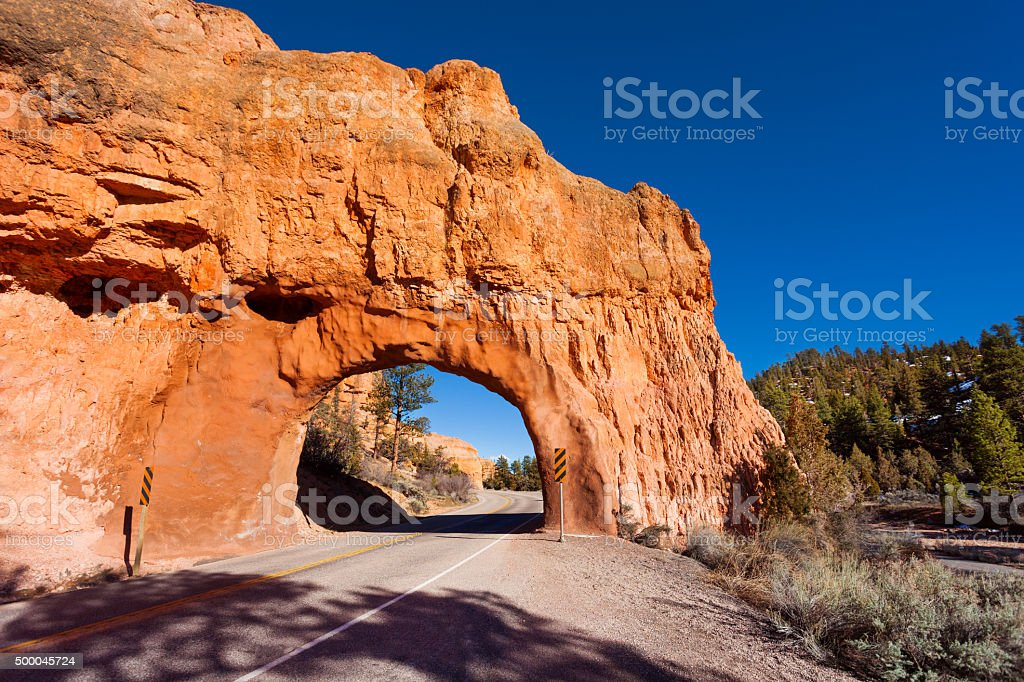 Road arc tunnel in Red Canyon, Utah, USA stock photo
