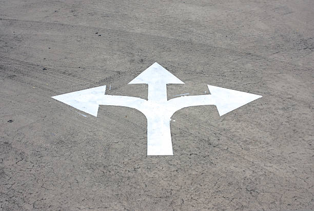 road arrow direction - three people stock photos and pictures