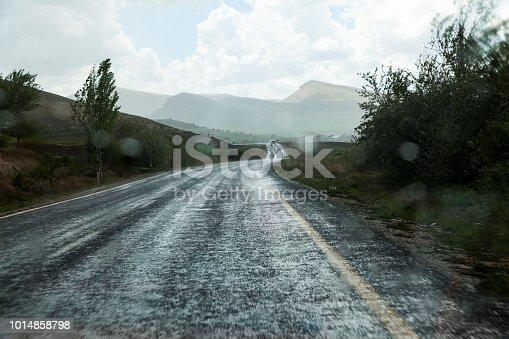 istock Road asphalt snowfall. 1014858798