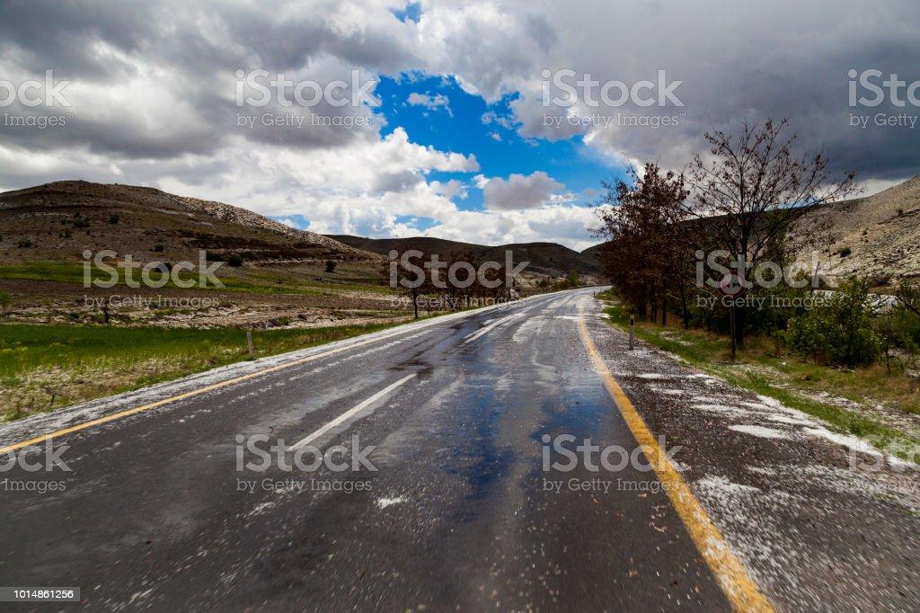 Road asphalt snowfall in first winter time.