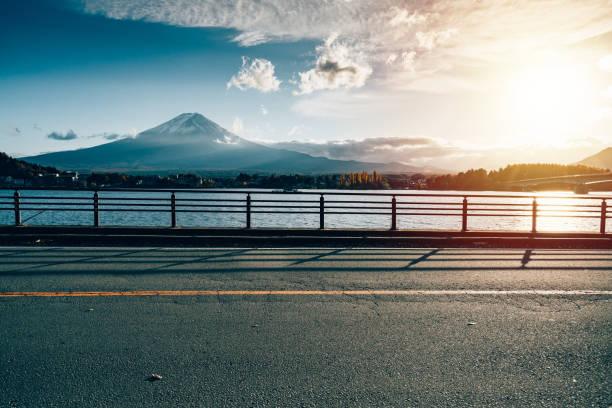 Road at Kawaguchiko, Fuji mountain landmark in japan, morning sky in autumn. Road at Kawaguchiko, Fuji mountain landmark in japan, morning sky in autumn. lake kawaguchi stock pictures, royalty-free photos & images