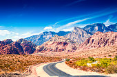Photo of a road at Red Rock Canyon, Nevada. Dramatic sky