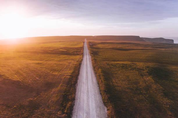 straße bei sonnenuntergang - aerial overview soil stock-fotos und bilder