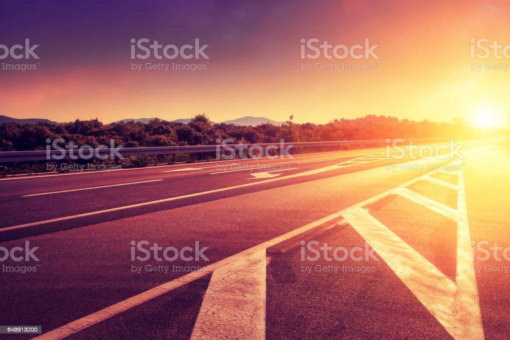 Road at sunset time stock photo