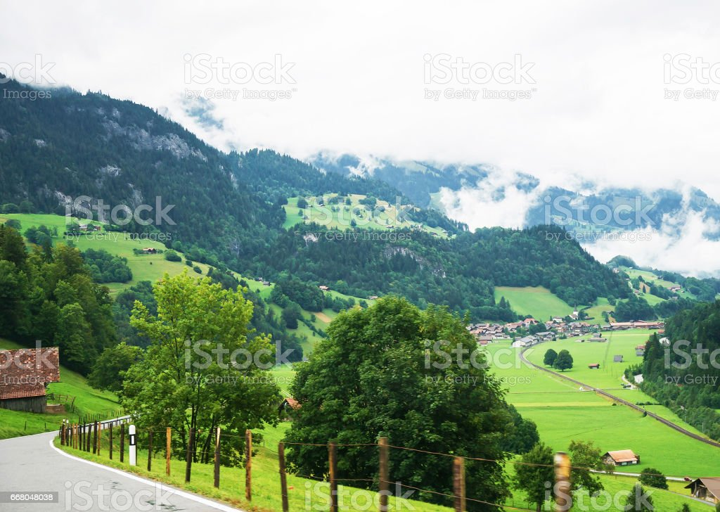Road at the village of Boltigen with Swiss Alps at Jaun Pass in Fribourg canton stock photo
