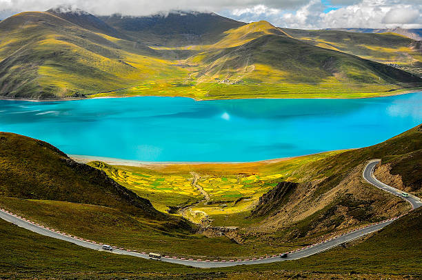 Road at Yamdrok Lake in Tibet stock photo