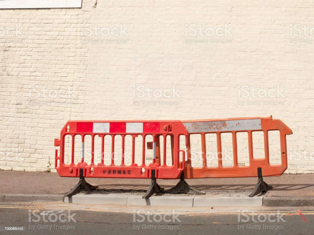 road barrier on street outside stock photo