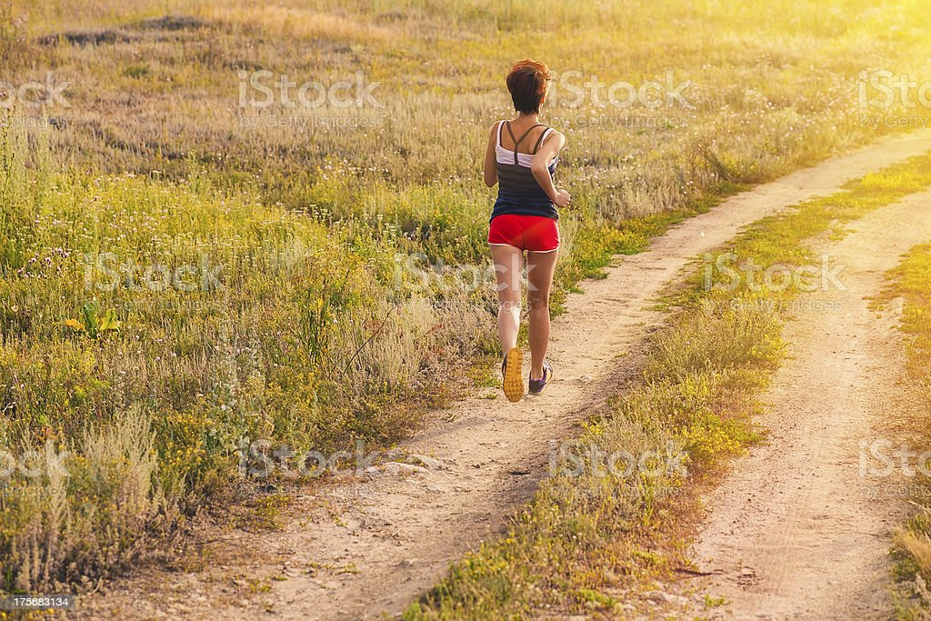road beautiful healthy brunette young woman athlete running outd royalty-free stock photo
