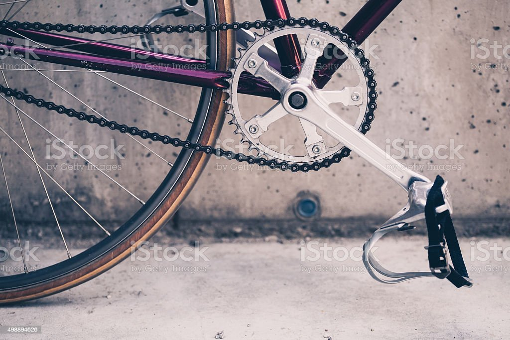 Road bicycle and concrete wall, urban scene vintage style stock photo