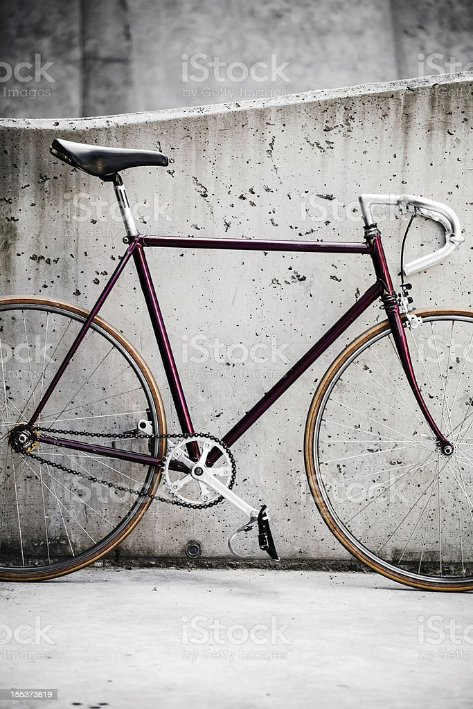 XXXL Road bicycle and concrete wall, vintage style royalty-free stock photo