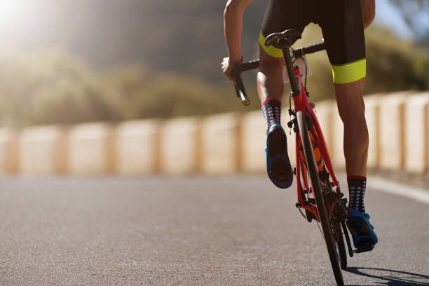 road bike cyclist man cycling - active lifestyle stock pictures, royalty-free photos & images