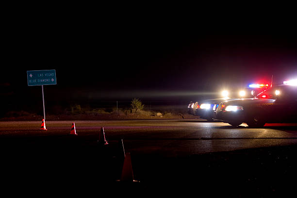 A road block during the night time Road block at Red Rock Fire, Las Vegas, Nevada trooper stock pictures, royalty-free photos & images