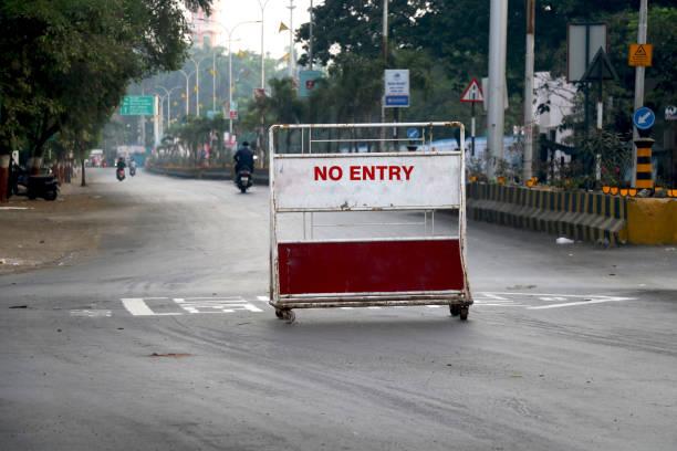 road block with barrier - lockdown foto e immagini stock