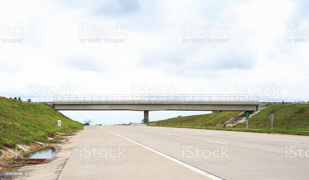 Road bridge across the direct highway stock photo