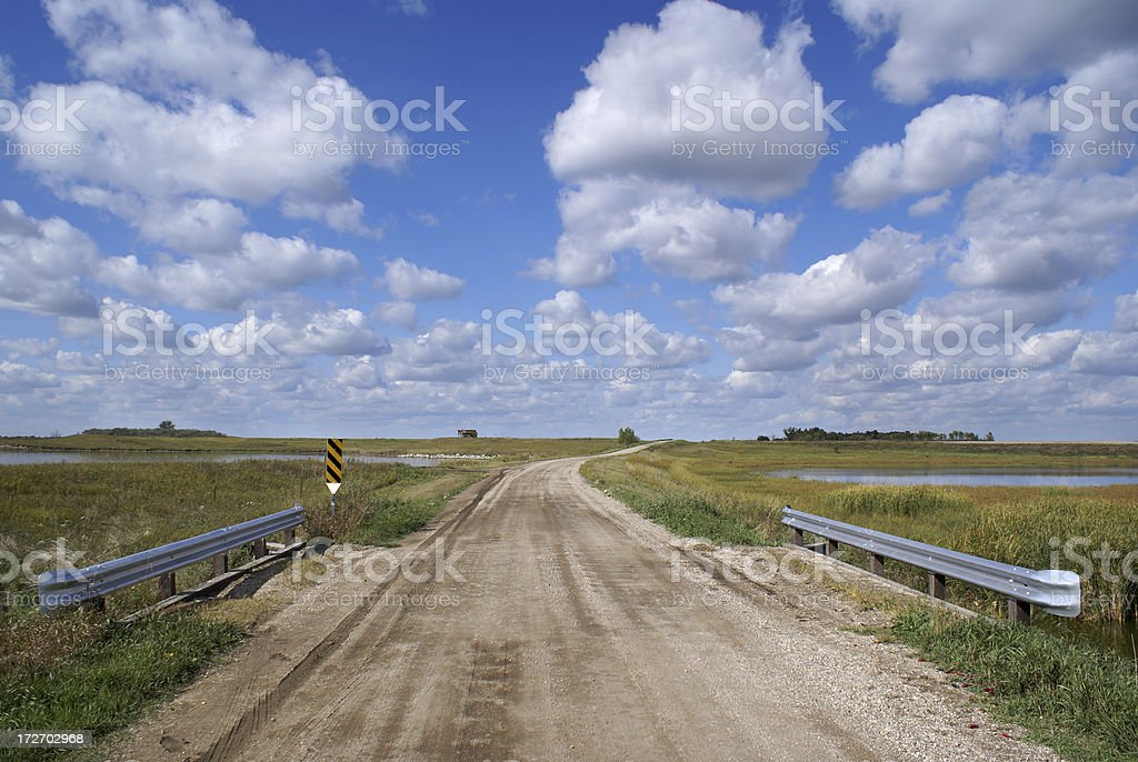 road, bridge, and clouds royalty-free stock photo