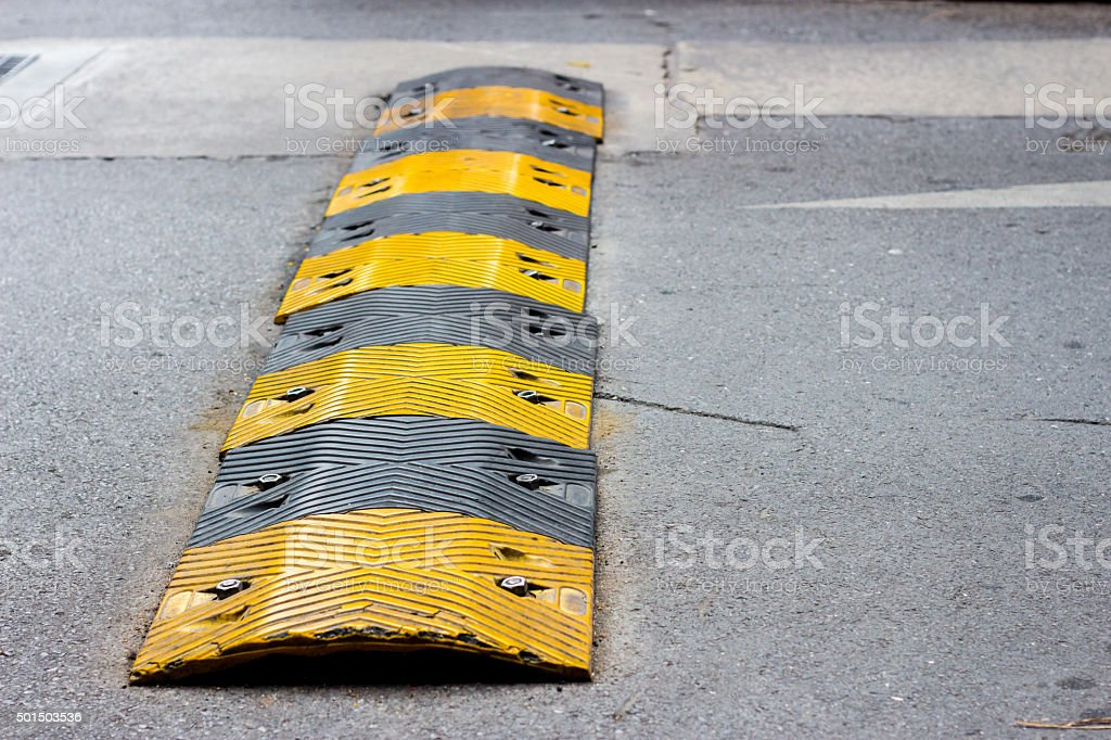 road bump in yellow and black stock photo