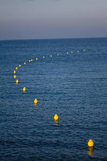 Road buoys at the sea stock photo