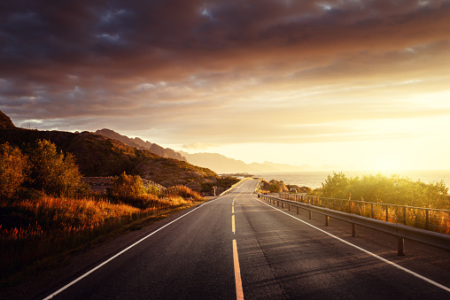 road by the sea in sunrise time,  Lofoten island, Norway