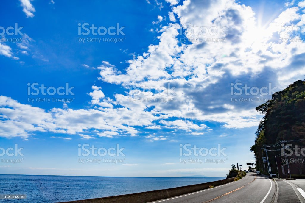 Road by the seas and refreshing sky