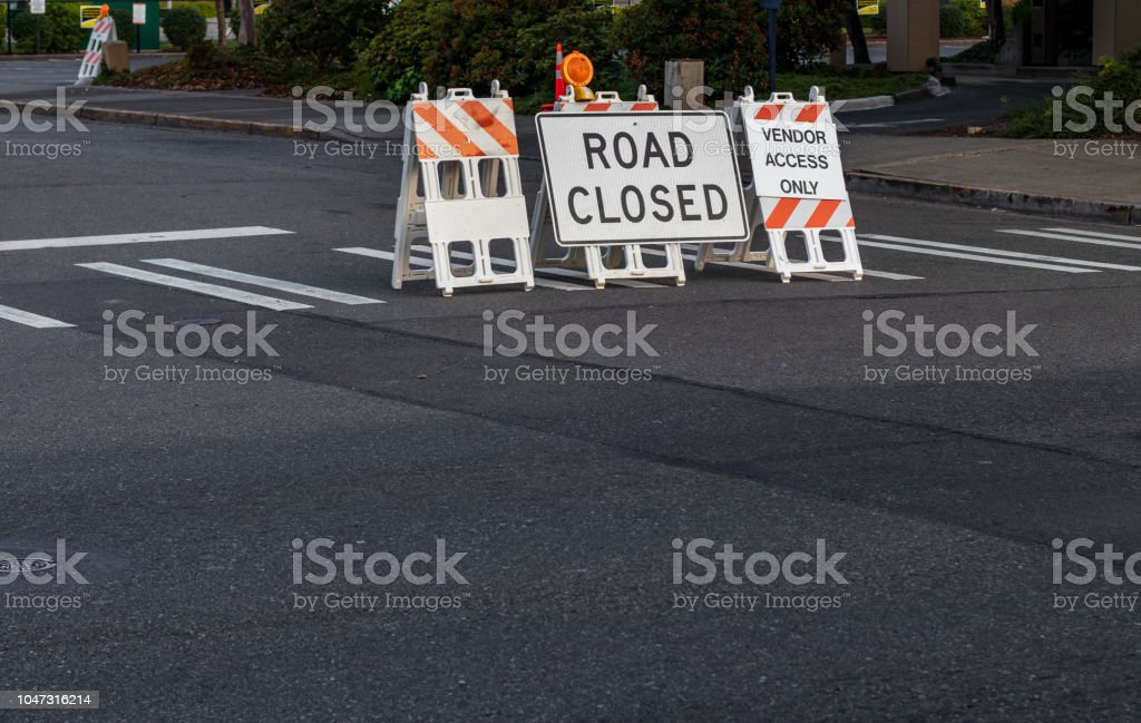 Road closed signs and barricades placed on a crosswalk stock photo