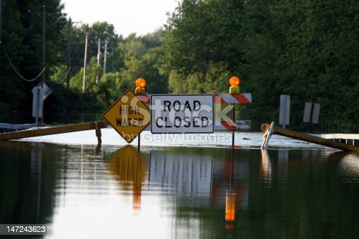 istock A road closure signage as water covers the road 147243623