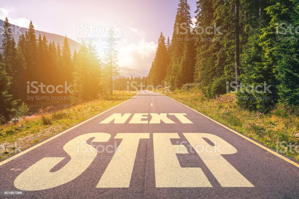 Road concept, Next Step written on the road in the mountains stock photo