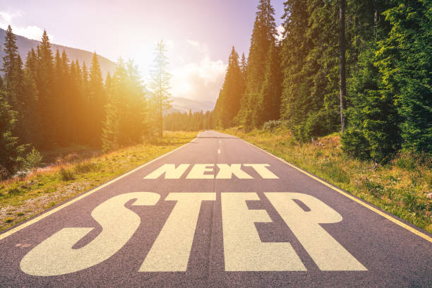 Road concept, Next Step written on the road in the mountains Road concept, Next Step written on the road in the mountains improvement stock pictures, royalty-free photos & images