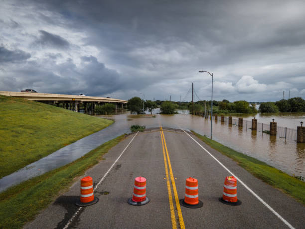 Road cones blocking flooded street stock photo