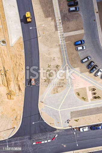road construction. road roller at asphalt pavement works. aerial view