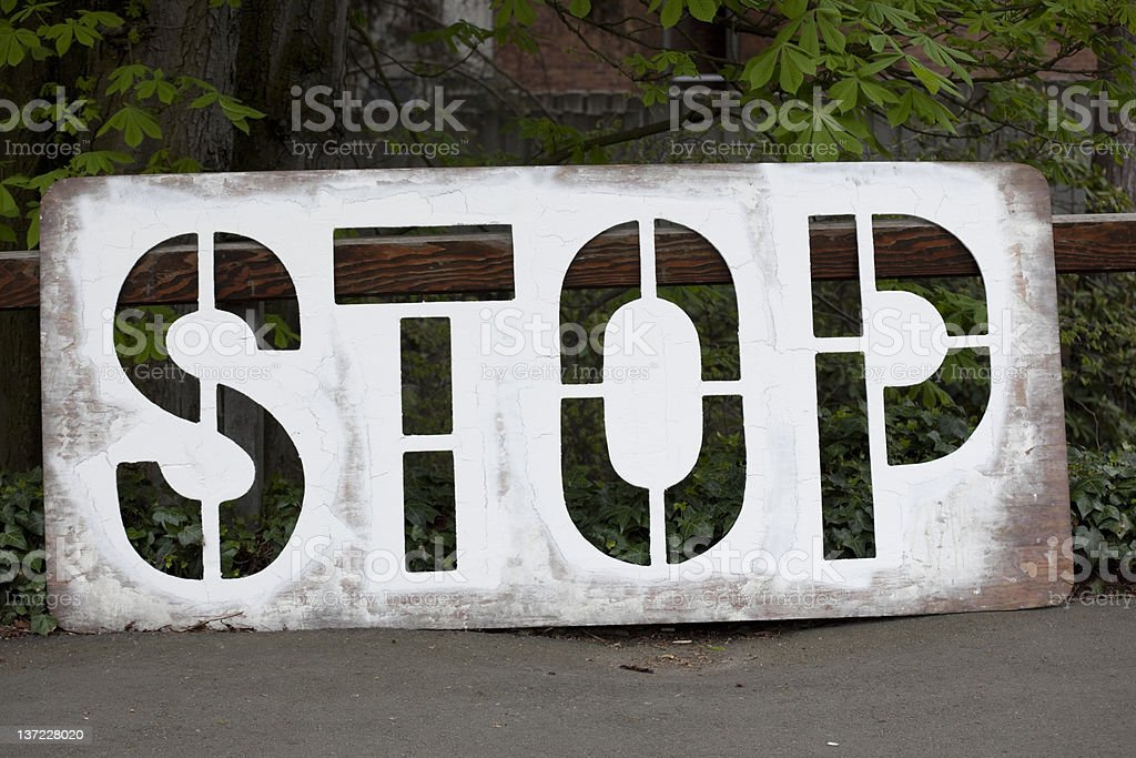 Road construction crew's freshly painted Stop Sign on street royalty-free stock photo