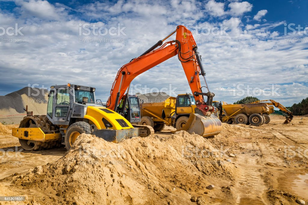 Road construction machinery on the construction of highway stock photo